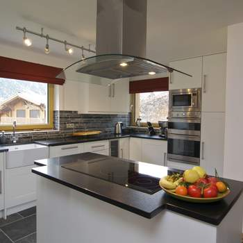 Modern designer Kitchen with induction hob and American fridge